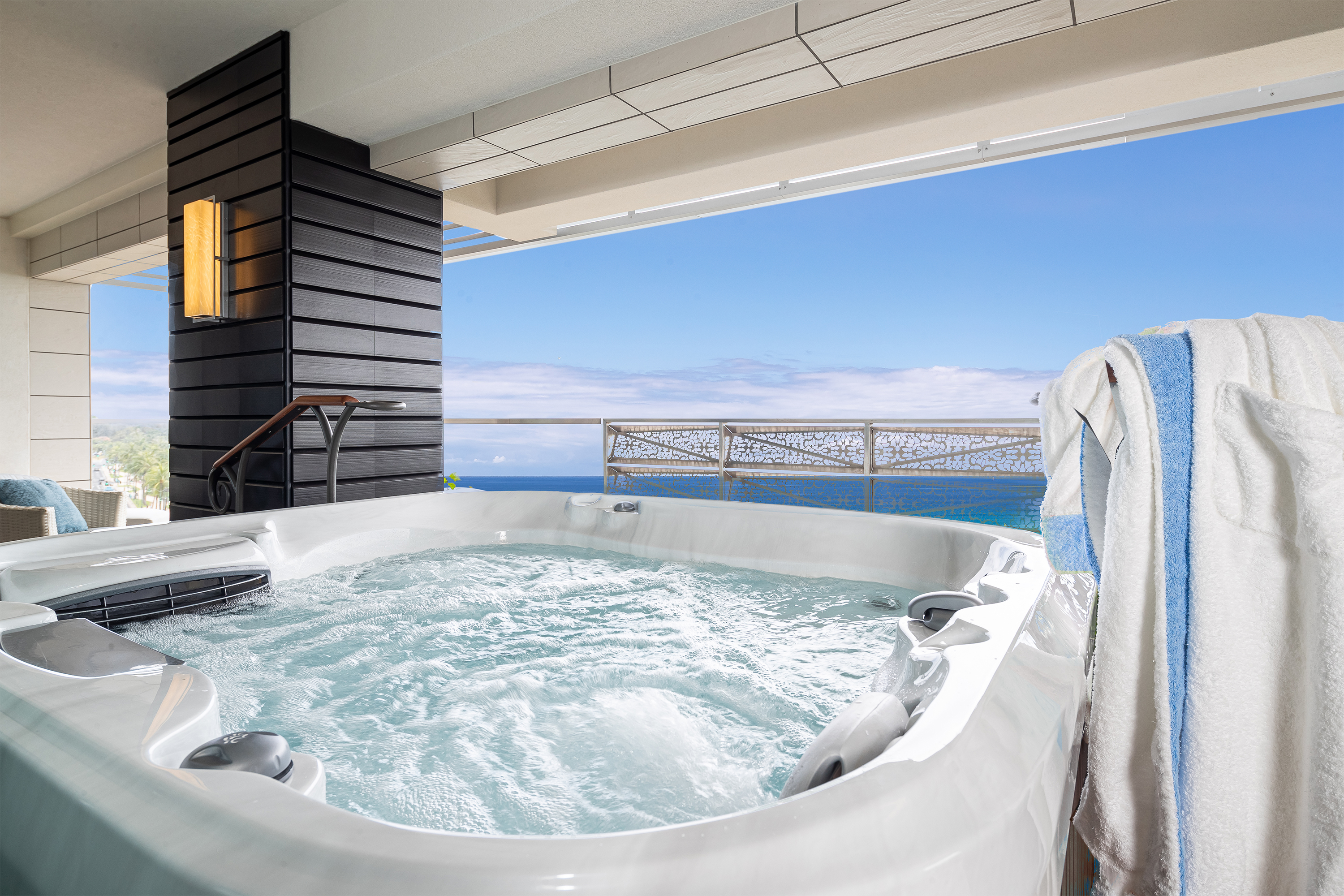 Jacuzzi on balcony with ocen views